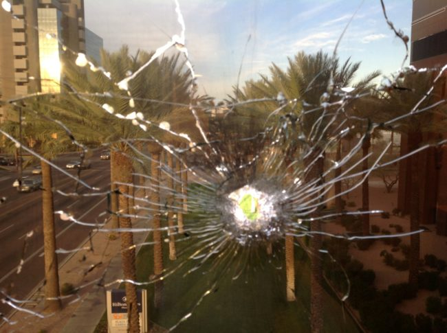 Upon further investigation, he realized that someone actually fired a gun at the glass.