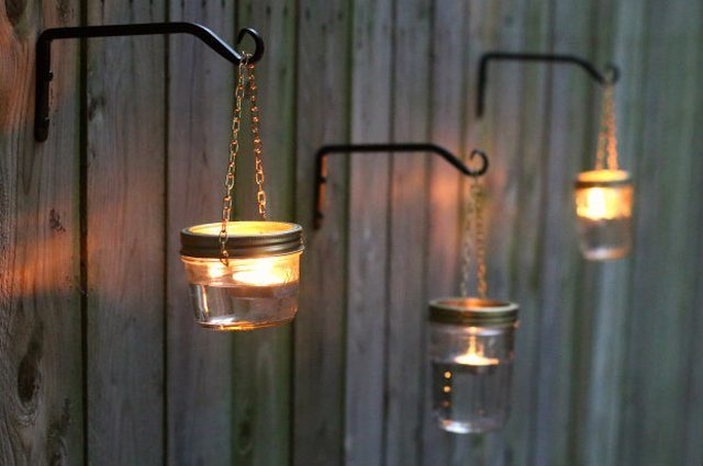 These mason jar lights add just the right amount of ambience to your backyard.