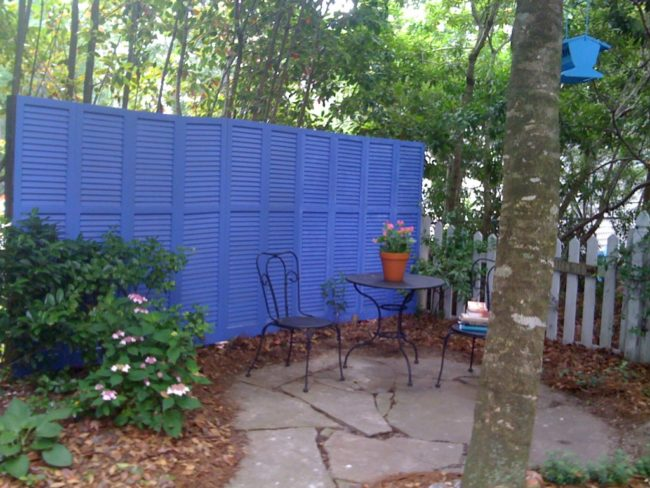 Opt for a more modern fence idea with recycled shutters.