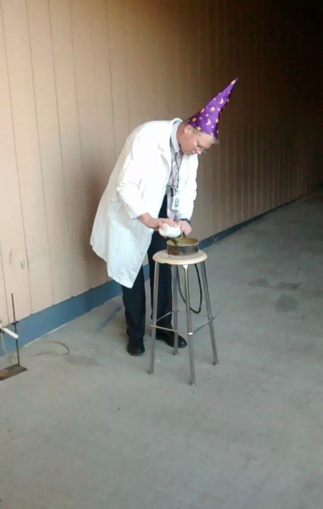 When this science teacher conducts experiments, he wears a sweet hat.
