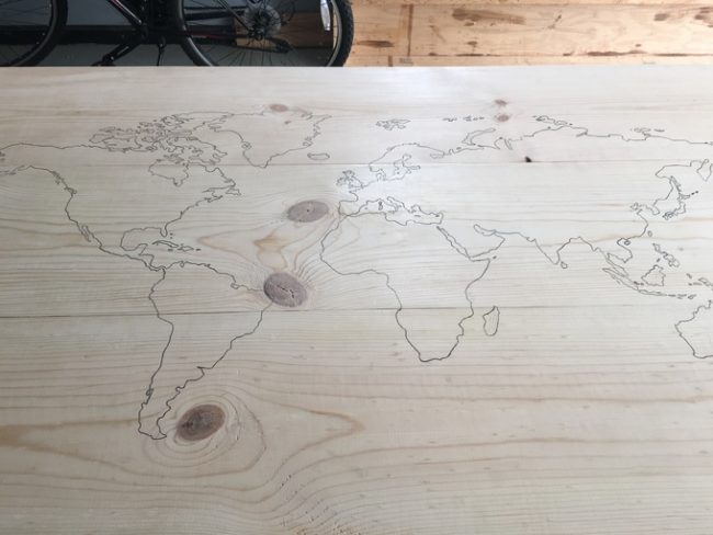 Next, he began tracing the countries onto the table so he would have an outline to color in.
