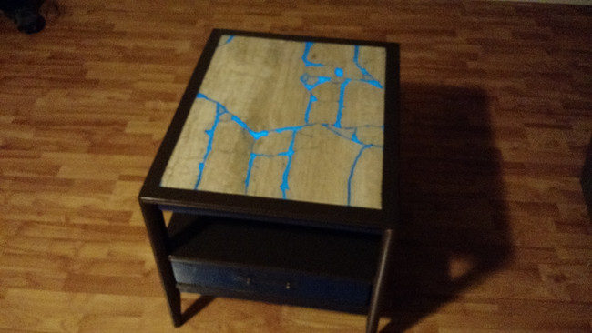 """Instead of throwing out a broken slab of marble, this crafter added glowing resin and made it a <a href=""""http://imgur.com/t/diy/KUBam"""" target=""""_blank"""">coffee table</a>."""