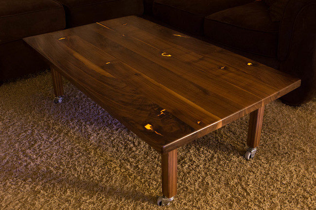 But you don't have to go with blue resin, here's a golden glowing table.