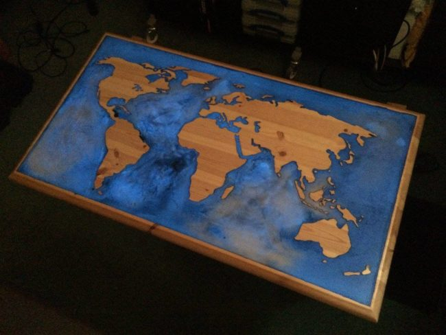 "This <a href=""https://www.reddit.com/r/DIY/comments/4ecdmn/glowinthedark_epoxy_and_pine_world_map_coffee/"" target=""_blank"">world map coffee table</a> is surrounded by glow-in-the-dark resin which is fitting for the ocean."