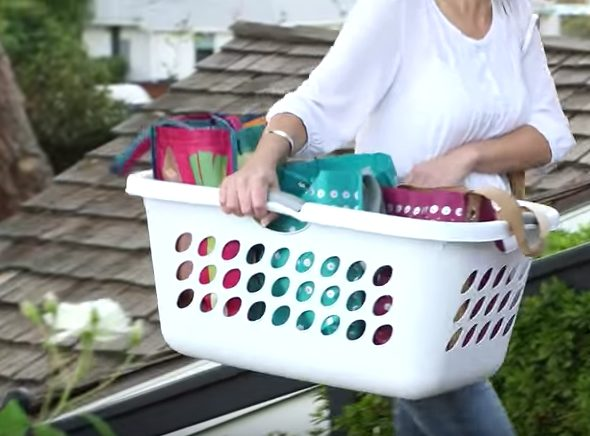 Keep a plastic laundry basket in your trunk to make carrying multiple bags into the house easier on your back.