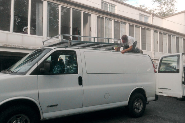 Outside, zachboth outfitted the van with a Hummer's roof rack.