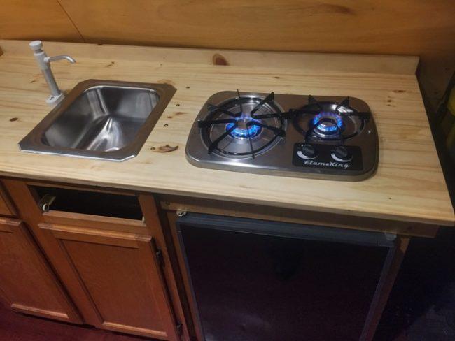 A sink, burner, and refrigerator were also installed.
