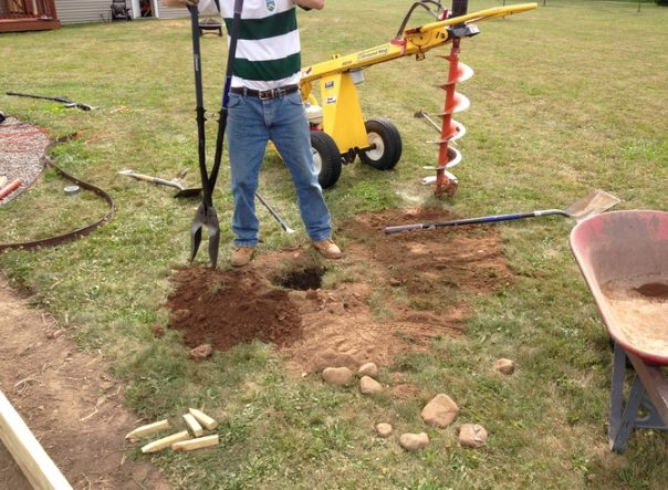 With some help from his father-in-law, he dug holes that'd eventually hold support beams.