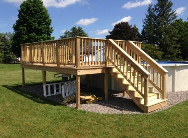 """If you want to bring a little life to your above-ground pool with one seriously beautiful deck, check out crafter <a href=""""http://imgur.com/a/OFEJd"""" target=""""_blank"""">FoxK56</a>'s project below!"""