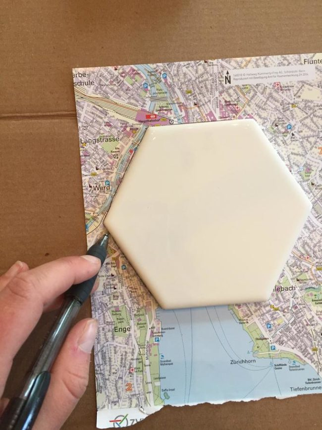 First, GoldenBaby traced out the portions of the maps that they wanted to use for the coasters.