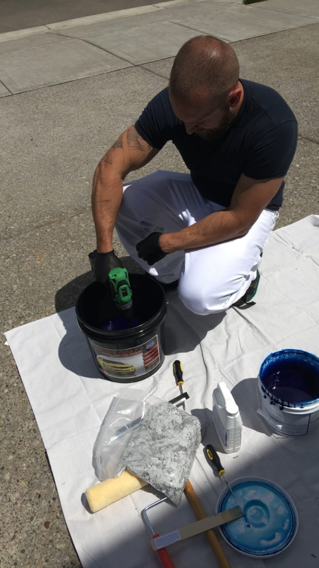 He grabbed a drill mixer and got the ball rolling with some blue epoxy.