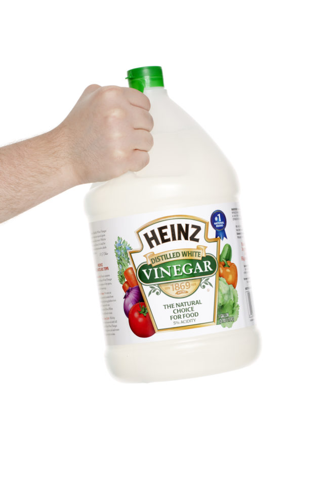Combine four liters of vinegar, 250 grams of table salt, and one tablespoon of hand soap to make your own weed killer.