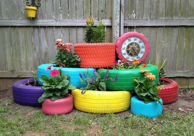 Paint your worn-out tires and turn them into unique planters.