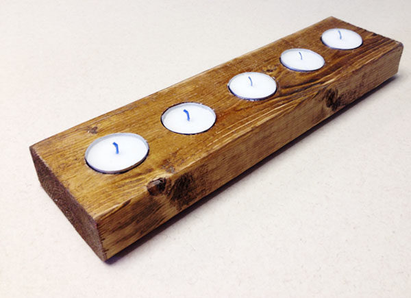 """Who knew two-by-fours could look so elegant...and serve as <a target=""""_blank"""" href=""""http://www.somewhatsimple.com/diy-a-quick-and-quirky-candleholder/"""">candleholders</a>?"""