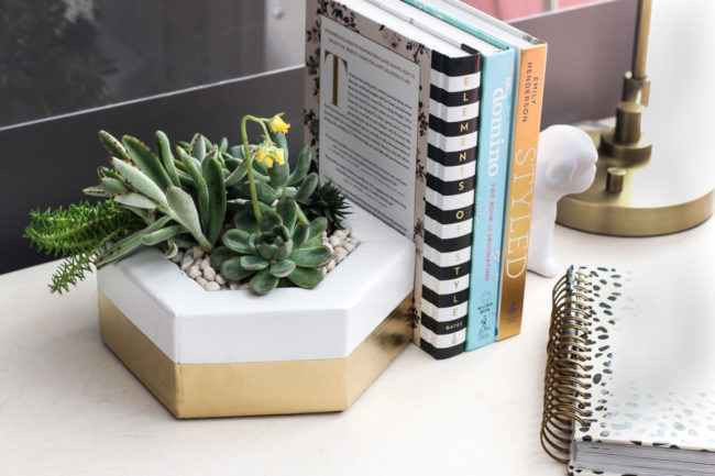 "This beautiful <a target=""_blank"" href=""http://jenwoodhouse.com/2x4-building-challenge/"">hexagon planter</a> also serves as a bookend."