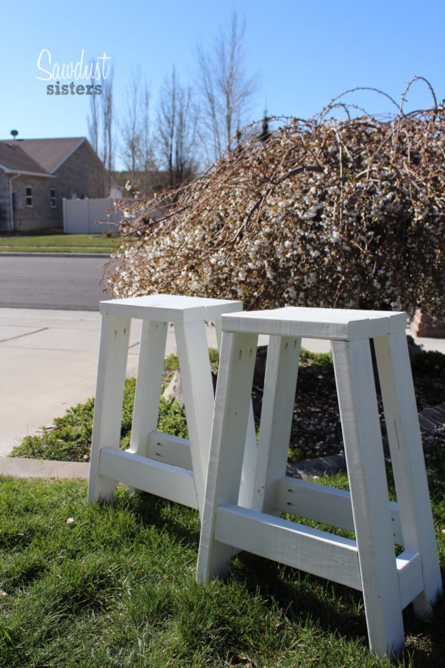 "These <a target=""_blank"" href=""https://sawdustsisters.com/diy-barstool-using-only-2x4s/"">barstools</a> would work inside or outside as cute plant stands."