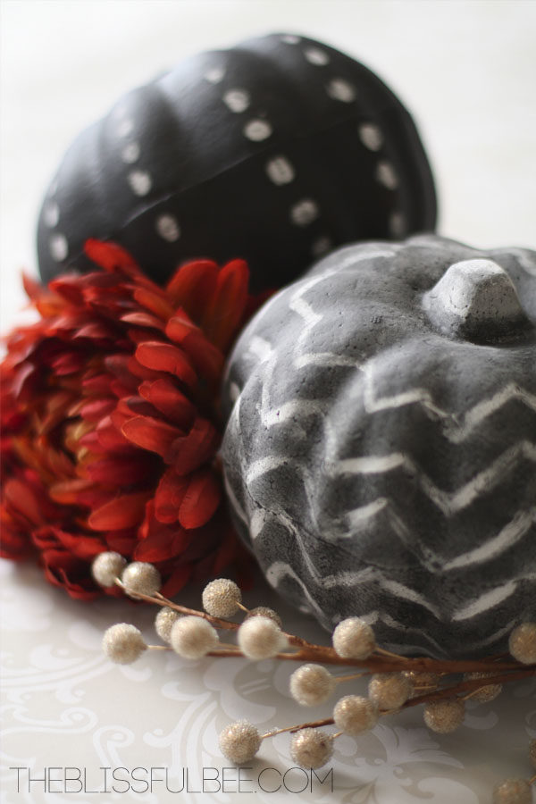 "Make seasonal decorations with these styrofoam <a target=""_blank"" href=""http://theblissfulbee.porch.com/dollar-store-chalkboard-paint-pumpkins/"">pumpkins</a>."