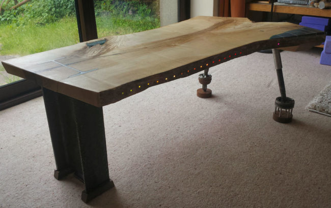 It's a pretty unique looking table, but it's hiding an awesome secret...