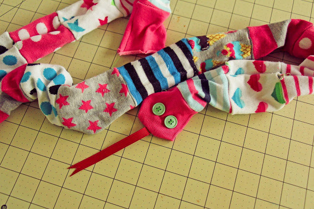 """If you can't find the strength to buy your kids a pet snake, try this <a href=""""http://www.grosgrainfab.com/2013/05/mismatched-socks-sew-sock-snake.html"""" target=""""_blank"""">alternative</a>."""
