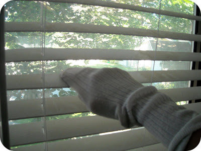 Put a sock on your hand to clean blinds easily!