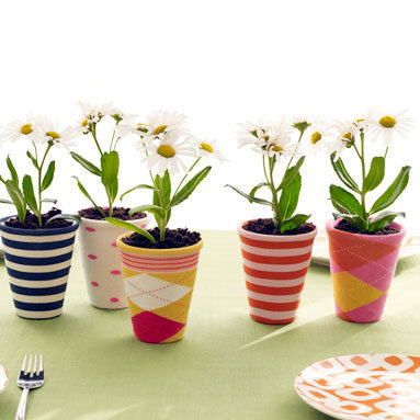 "Give your <a href=""http://decorhacks.com/2011/06/sock-covered-planters/"" target=""_blank"">potted plants</a> a makeover."
