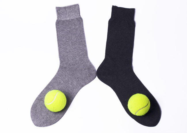 Covering a tennis ball with a sock and placing it in the dryer will eliminate static cling and dry your clothes quickly.