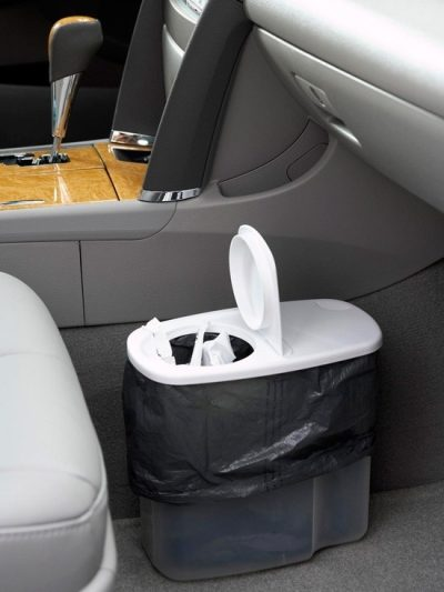 Turn a plastic cereal container into a trash can for your car.