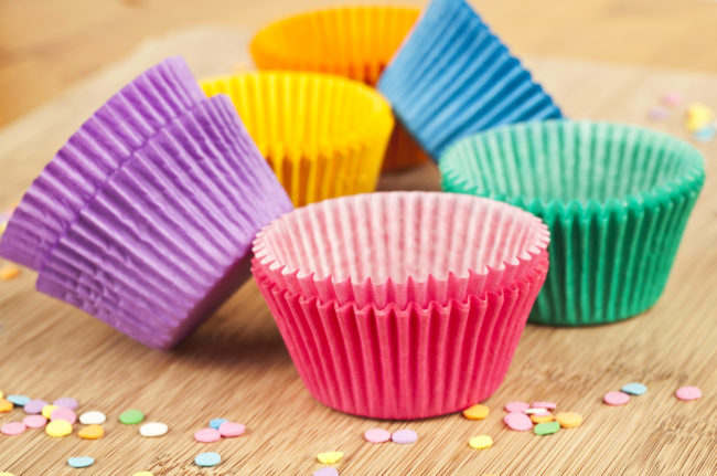 Line your cupholders with cupcake wrappers to cut down on sticky messes.