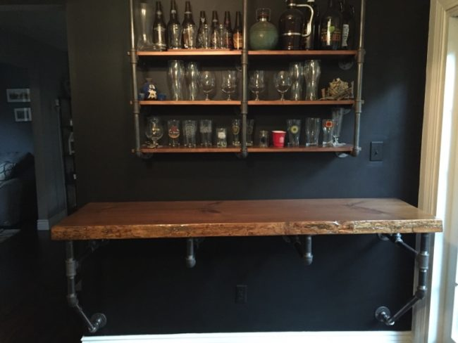 For the last step, he used drywall screws to attach the bar to the wall. It looks so cool!