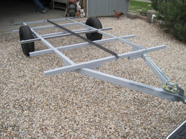 He welded a frame equipped with crossbars for stability.