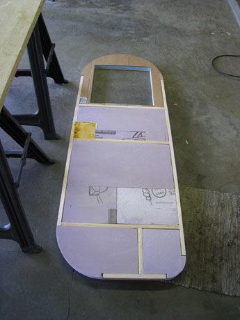 Then he worked on building the camper door.