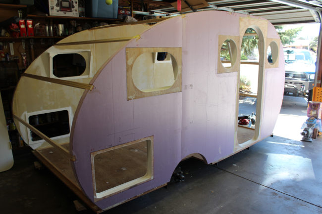 The crafter installed the walls of the camper and covered the interior with durable canvas.