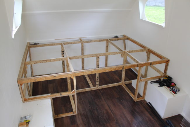 The builder needed a place to sleep, so he began building a bed frame.