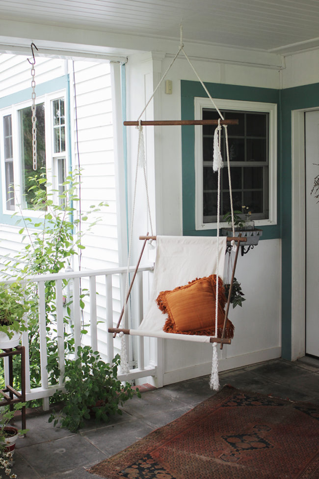 """No patio is complete without a <a href=""""http://themerrythought.com/diy/diy-hanging-lounge-chair/"""" target=""""_blank"""">hanging chair</a>."""