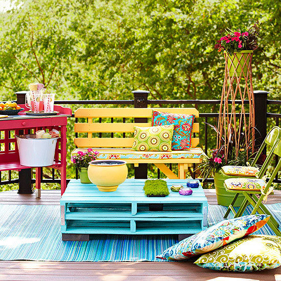 By adding some bright colors, a rug, and some throw pillows, you can really make your space pop.