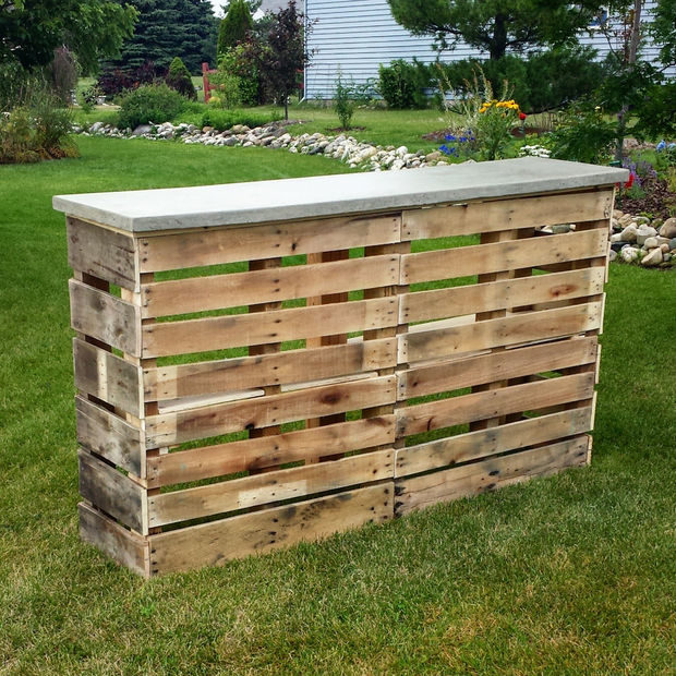 """Don't forget to tip the bartender! Break in your <a href=""""http://www.instructables.com/id/Pallet-Patio-Bar-with-Concrete-Top/"""" target=""""_blank"""">new bar</a> with a backyard party."""