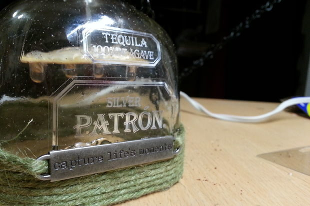 """<a href=""""http://www.instructables.com/id/Patron-led-hanging-patio-lights/"""" target=""""_blank"""">These lights</a> might rack up a hefty bar tab, but you won't remember it in the morning."""