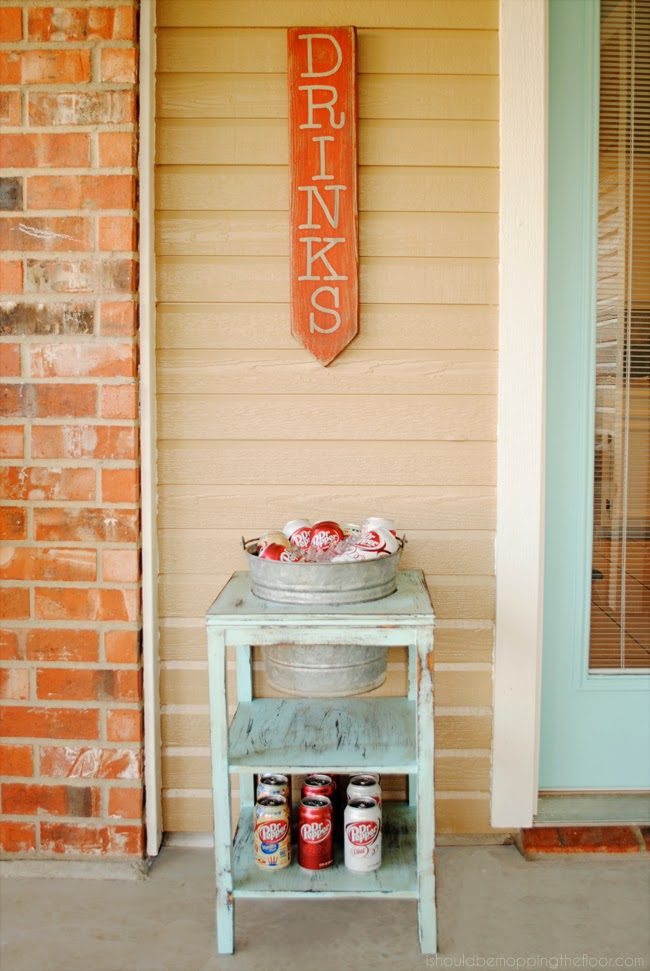 """Your patio isn't complete without an awesome <a href=""""http://www.ishouldbemoppingthefloor.com/2014/07/diy-drink-station.html"""" target=""""_blank"""">drink station</a>."""