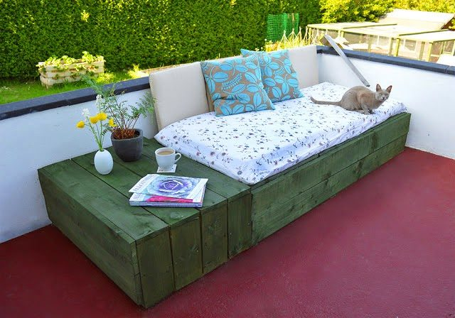 """Wooden pallets can be used to build a variety of things, like this <a href=""""http://lovelygreens.com/2013/06/pallet-project-patio-day-bed.html"""" target=""""_blank"""">daybed</a>."""