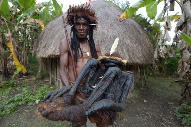 Here, the Dani tribe chief Eli Mabel is holding the remains of his ancestor Agat Mamete Mabel.