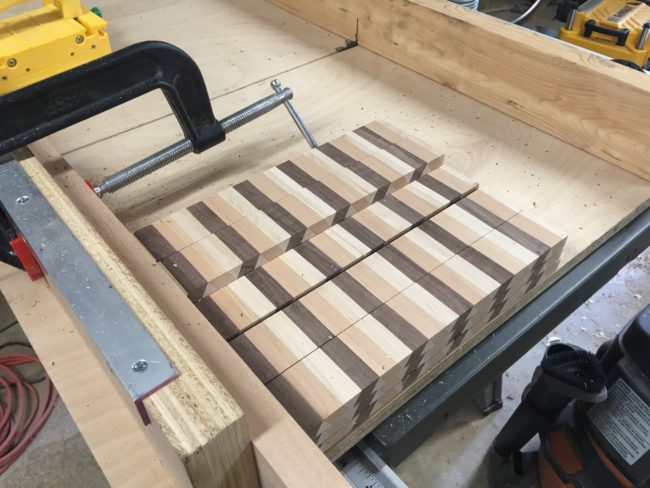 "Next he crosscut tiles of wood to 1.75"", the eventual thickness of the cutting board."