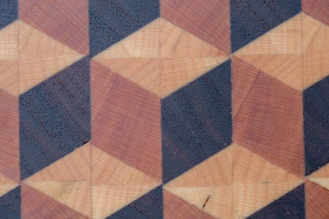 A close-up of the grain and the 3-D design of the board.