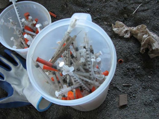 Those are two buckets filled with hypodermic needles collected near an underpass in the University Park neighborhood of Portland.