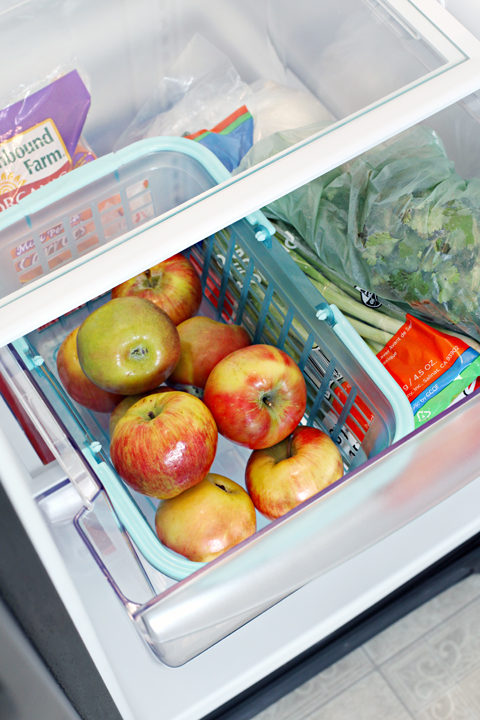 "Put a <a target=""_blank"" href=""http://www.iheartorganizing.com/2014/03/monthly-clean-home-challenge_7.html"">basket</a> in your crisper drawer to easily keep all your apples together."