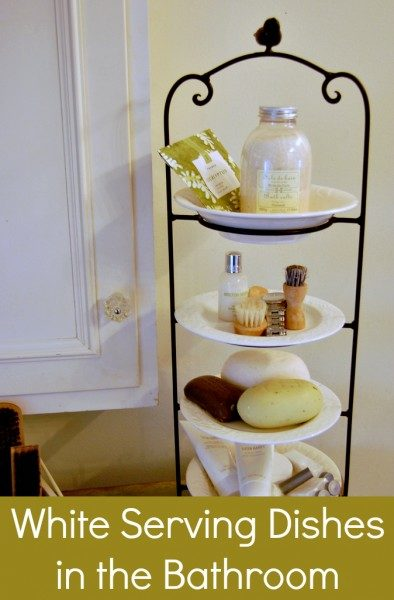 "Put <a target=""_blank"" href=""http://blissfullydomestic.com/home-bliss/more-white-dish/1459/"">serving dishes</a> in a rack to hold all your bathroom items."