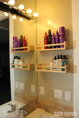 "Keep your hair products organized by hanging <a target=""_blank"" href=""http://suiterevival.blogspot.com/2011/10/bathroom-tour.html"">spice racks</a> in your bathroom."