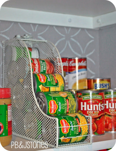 "Use a <a target=""_blank"" href=""http://www.pbjstories.com/2011/08/kitchen-pantry-reveal.html"">magazine holder</a> to store all your canned goods for easy access."