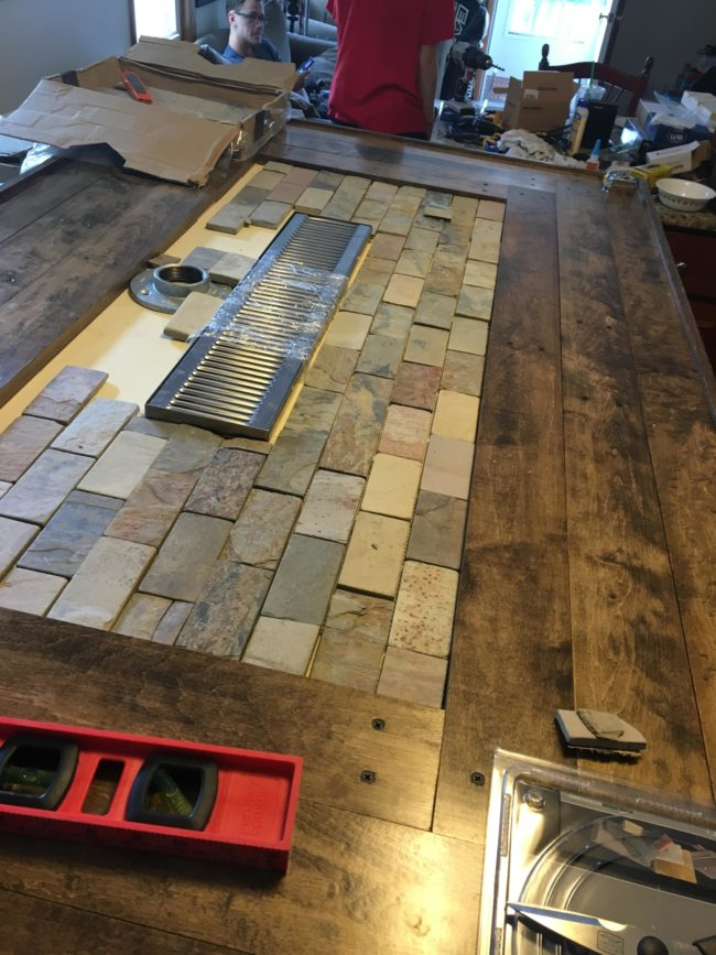 He installed the drainage system and gave the counter an awesome tiled look.