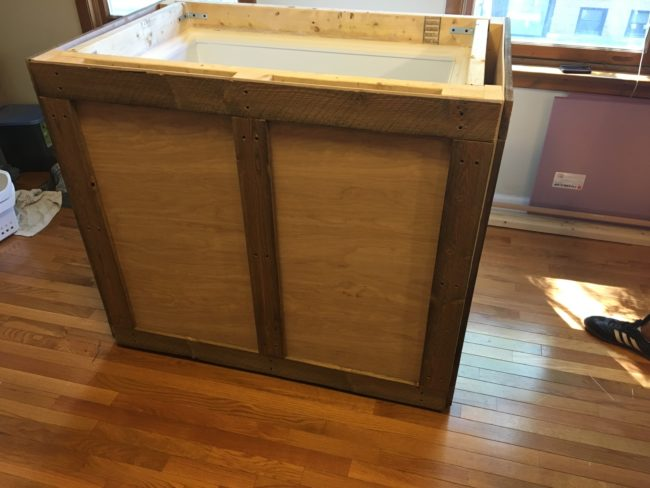 He created a rustic frame to surround the box freezer.