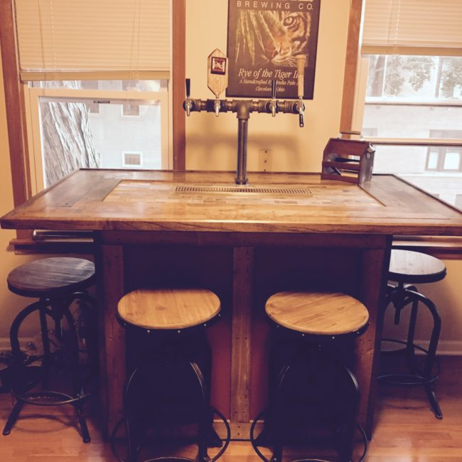With an awesome bar setup like this, you could open up your very own pub.